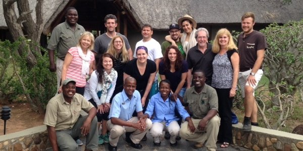 A Lion World Travel group celebrates at Jackalberry Lodge in South Africa