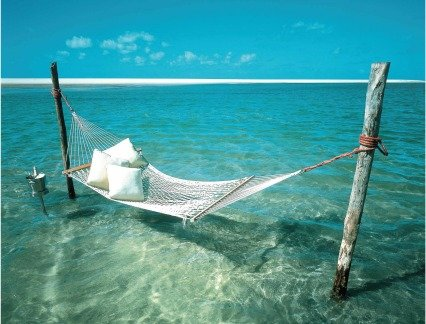 A Hammock suspended over water